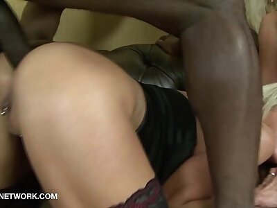 Light-complexioned matures facials and swallow in hardcore interracial prearrange carnal knowledge